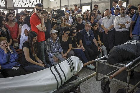 The family and friends of Emanuel and Miri Riba say a final farewell before they are laid to rest in Israel after their murder May 24, 2014 by a French-born terrorist while visiting the Jewish Museum in Brussels.