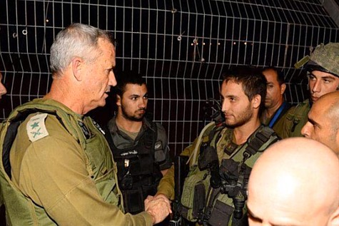 Benny Gantz at the Tapuach Junction greeting the soldier who killed the terrorist.