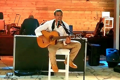 Eyal Yifrach, playing and singing at his cousin's wedding, just a few months ago.