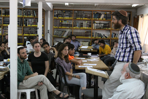 Rabbi Yair Dreifus leads study session for secular, Orthodox students at Efrat's Yeshivat Siach Yitzhak, June 17, 2014