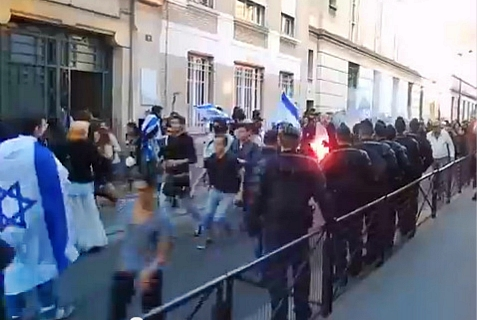 "A rally in Paris to ""Bring Back Our Boys"" was attacked by anti-Semites with burning flares."