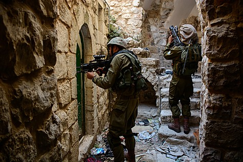 IDF soldiers carrying out a search in Hebron this summer. (illustrative only)