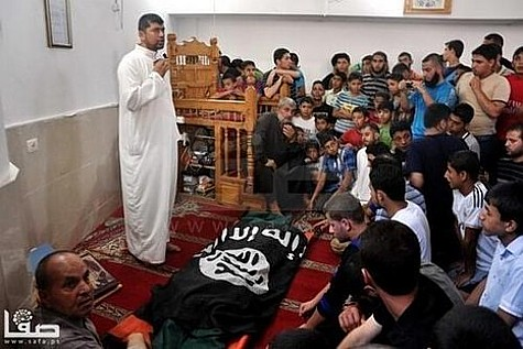 """I would rather die than accept Israeli blood."" A Gazan terrorist wrapped in an ISIS flag at his funeral."
