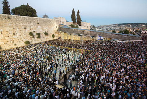 Jews from across Israel's political and religious spectrums gathered at the Kotel on Sunday for a massive prayer rally for the safe return of three kidnapped Israeli teenagers.