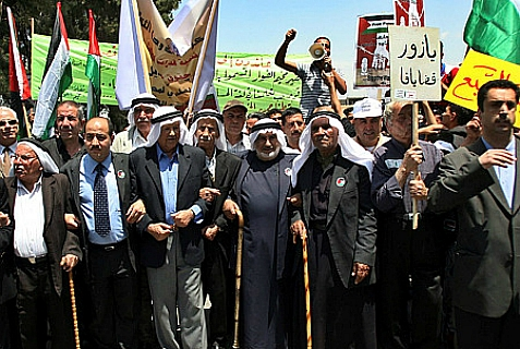 Palestinians during a rally in the West Bank town of Ramallah, 15 May 2007, to mark the 59th anniversary of the 'Nakba,' or 'catastrophe', that refers to the creation of the state of Israel.