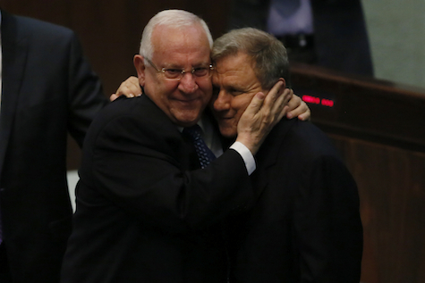 President-elect Reuven Rivlin embraces challenger MK Meir Sheetrit prior to second round of voting