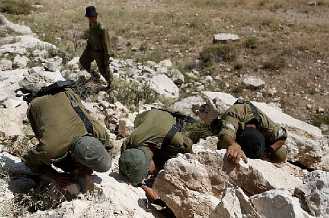 IDF soldiers search under rocks, in caves and also the wells in the fields of Judea, looking everywhere for the kidnapped teens.