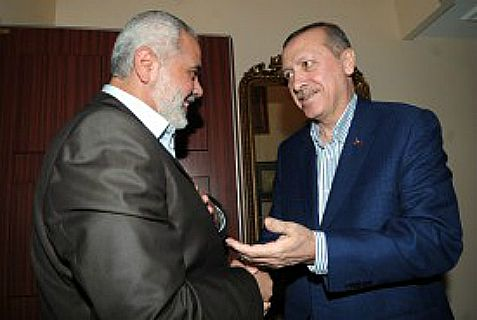 Hamas' leader Ismail Haniyeh (L) and Turkish President Recep Tayyip Erdogan.  (R)