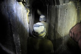 An IDF soldier guards the entrance of a Hamas terror tunnel, October 13, 2013