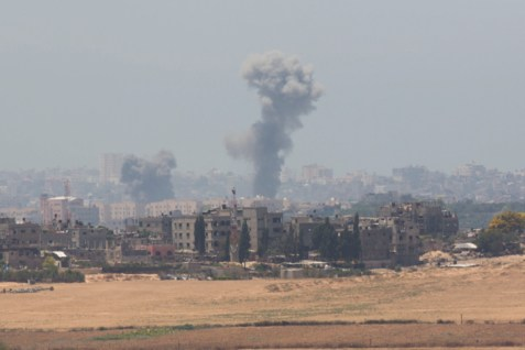 Smoke rises from Gaza after an Israeli air strike, July 9, 2014