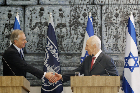 Shimon Peres and Tony Blair shake hands s in Jerusalem.