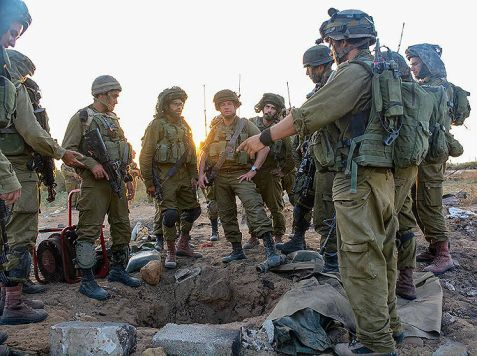 Givati soldiers standing over a Hamas terror tunnel.
