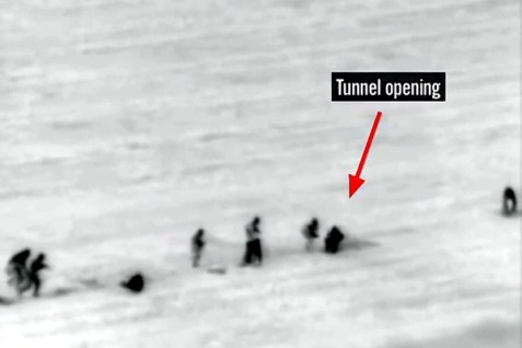 Terrorists are seen emerging from a terrorist tunnel just a few meters away from a kibbutz near the Gaza border.
