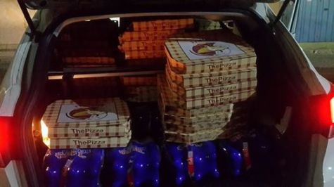 Jameel's car, packed with pizzas for the soldiers.