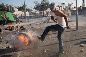 Palestinians clash with  border police during funeral of Mohammed Abu Khdeir,  July 4, 2014.