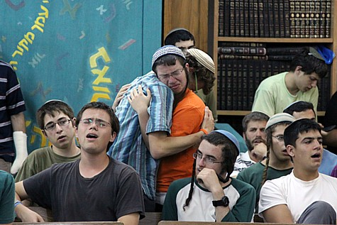 Student at the Makor Chaim Yeshiva in Kfar Etzion mourn the murder of their friends and fellow students Gil-ad Shaar and Naftali Fraenkel.