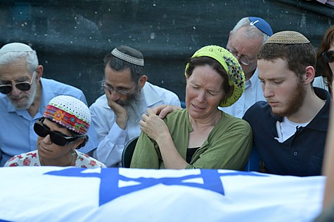 Mother of Naftali Frenkel, Rachel Frenkel, seen crying over the body of her son, during the joint funeral for the three murdered Jewish teens, in the Modiin cemetery, on July 1, 2014.