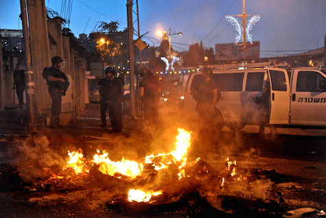 Police clash with protesters in Nazareth, Israel, July 5, 2014