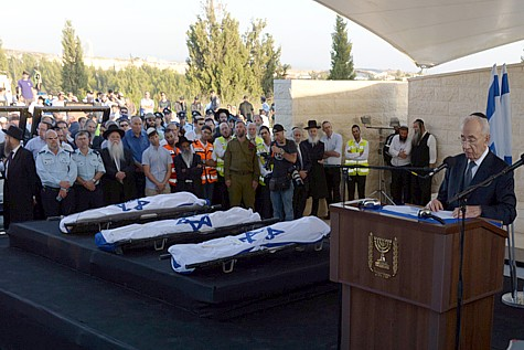 United in grief: President Shimon Peres eulogizes the three murdered Jewish boys,  July 1, 2014.
