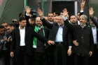 Hamas leader in exile Khaled Meshaal (R) and Hamas prime minister in the Gaza Strip Ismail Haniya (L) gesture to the supporters during a rally
