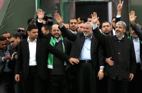 Hamas leader in exile Khaled Meshaal (R) and Hamas prime minister in the Gaza Strip Ismail Haniya (L) gesture to the supporters during a rally to mark the 25th anniversary of the founding of the Islamist movement, in Gaza City on December 8, 2012. to mark the 25th anniversary of the founding of the Islamist movement,  in Gaza City on December 8, 2012.