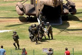 Soldiers take wounded comrade wounded in Gaza from helicopter to Soroka Hospital in Be'er Sheva.