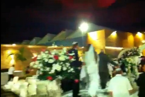 An Israeli wedding couple flees seconds after a rocket exploded overhead at their wedding.