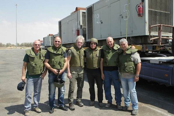 Israel Electric Company workers fitted with military flak jackets.