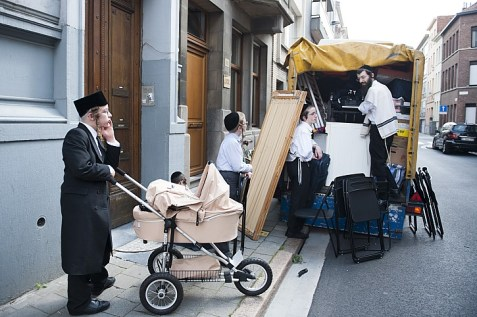 One way to escape anti-Semitism in Europe: Orthodox family packs up in Antwerp on their way to moving to Israel.