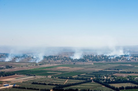 Smoke rises near Quneitra Crossing as it seen from the Golan Heights, August 27, 2014.