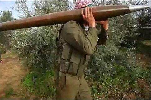 Gaza terrorists prepare Grad missiles for launching at Israel. (archive)