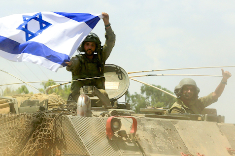 IDF soldiers enter the Gaza Strip, 18 July 2014.