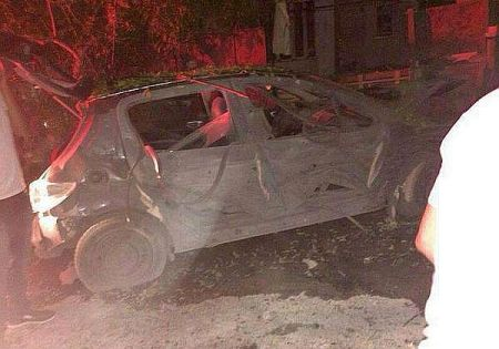 Car hit by Grad missile in Be'er Sheva, August 23, 2014.