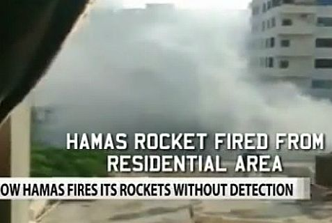 Indian TV catches Hamas firing rocket next to hotel.