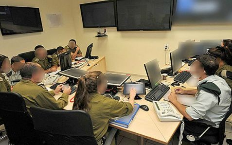 Blurred faces, for security reasons, lead the IDF's secret defense against anti-Israel cyber warfare.