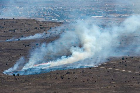 Smoke rises near Quneitra Crossing as it seen from the Golan.Heights . (Archives.)