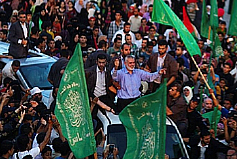 Hamas's leader in Gaza, Ismail Haniyeh (in blue shirt, center), benefitted politically - and in a dramatic fashion - from this summer's war.  Photo from Hamas victory rally, Aug. 27, 2014.
