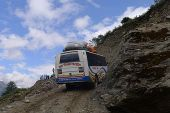 Bus on mountain road in Nepal, 2014.