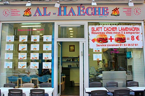 The Al Haeche kosher restaurant in Paris had bullet holes through the front window. Dec. 24, 2014.