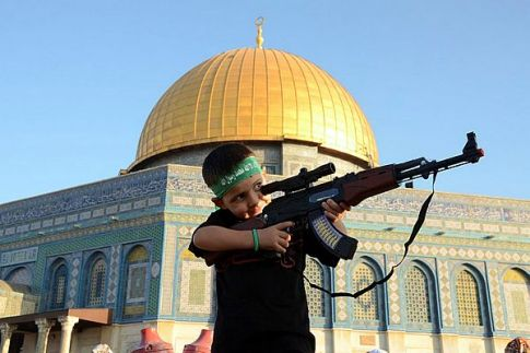 Future guard? Arab child with Hamas headband aims toy rifle on the Temple Mount after prayers in the Al Aqsa mosque. (Archive)