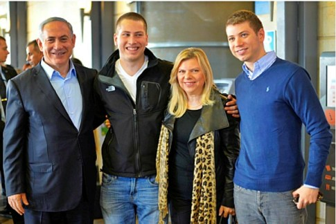 Israeli Prime Minister Benjamin Netanyahu and his wife Sara, with their sons Yair (R) and Avner (2L),  on December 01, 2014.