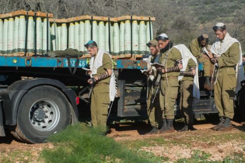 Israeli soldiers praying as IDF forces seen reinforcing presence in the Golan Heights Northern Israel.
