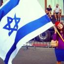 Jewish Press blogger Jordana Brown, holding the flag of her adopted, beloved homeland