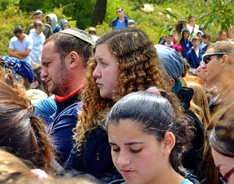 Israeli crying at Yom HaZikaron Ceremony at Gush Etzion Regional Cemetery, April 22, 2015.