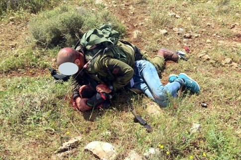 Soldier tackles terrorist who stabbed him bear the security fence in Samaria, east of Tel Aviv.