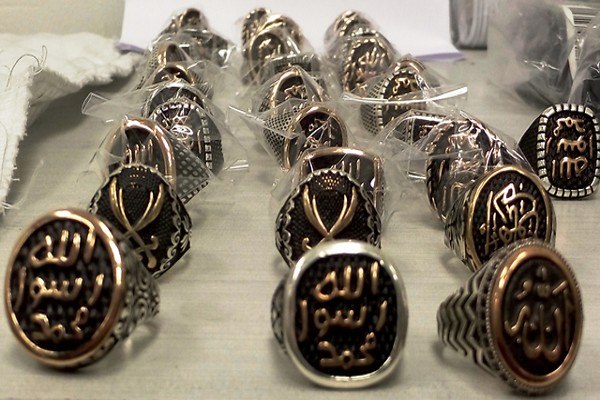 Rings with Islamic State slogans on them.