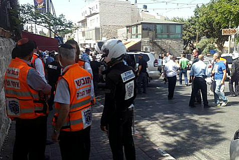 Police at the scene of a terrorist's hit and-and-run attack on policemen in eastern Jerusalem Wednesday morning.