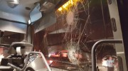 Windshield of a bus broken in a stone-throwing attack.  ((archive)