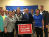 Mike Huckabee with his campaign slogan: 'Hope to Higher Ground'