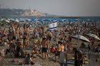 Thousands of Israelis and tourists on the beach in Tel Aviv.